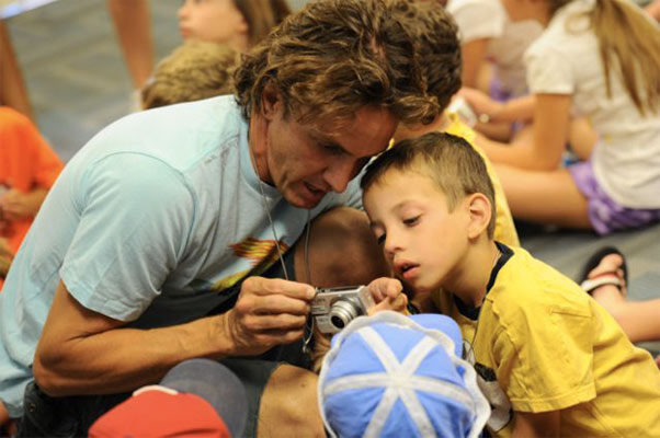 Photo of Michael Davie interacting with children